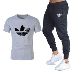 trousers red black men Coupons - Classic Brand Gyms clothing T Shirts+pants men set 2 piece kit tracksuit Joggers Brand Male Trousers Casual Pants Sportswear Set