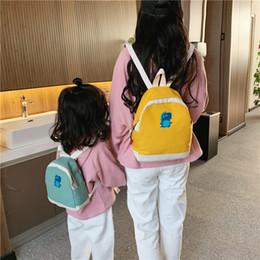 2019 mochila de cocodrilo Moda lona de los niños mochilas de alta calidad de la historieta de la impresión del cocodrilo padres e hijos del paquete niñas niños Mini Mochila de viaje mochila de cocodrilo baratos