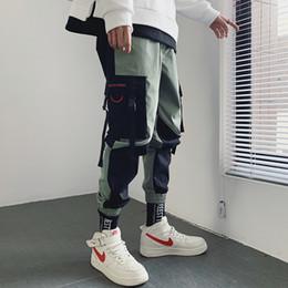 Sueltos pantalones de verano hombres online-pies de viga marca de la marea de los guardapolvos de los hombres pierden nueve puntos ins neta sección delgada rojo verano pantalones casuales versión coreana de la tendencia
