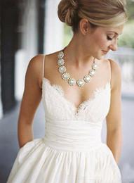 costura de espaguete Desconto Elegante cintas de espaguete a linha vintage vestidos de noiva de renda plissados saia de cetim com bolsos vestidos de casamento da praia do verão sem encosto