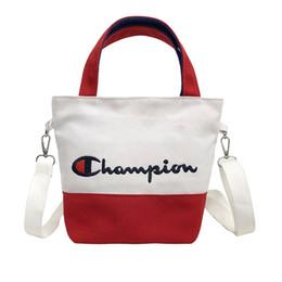 Macbook pro letras online-Mujeres Lienzo bordado campeones letras bolso Estudiantes Cinturón Bandolera bolsos de compras de viaje totalizador mini bolsos con cremallera C3156
