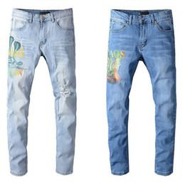 Calça jeans jeans para homem on-line-Luxo Jeans Mens Designer zipper afligido furo jeans de alta qualidade Casual Jeans Homens magros motociclista calça azul Tamanho 28-40