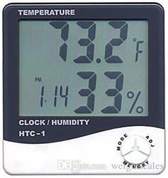 Termómetro digital lcd medidor de humedad de temperatura online-LCD digital Higrómetro de temperatura Reloj Medidor de humedad Termómetro con reloj Calendario Alarma HTC-1 100 piezas arriba