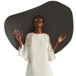 Sombreros plegables sol online-Tapa mujer de Sun de la manera sombrero grande Playa anti-UV de protección solar plegable de paja de gran tamaño plegable de la sombrilla de playa
