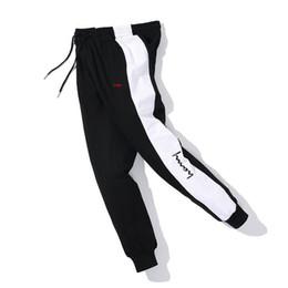 nuevos hombres pantalones de hip hop Rebajas Pantalones de marca para hombre diseñador para mujer 2019 Nueva llegada Hombres Mujeres Hip Hop Marca Jogger Pantalones Casual Unisex Hombres Mujeres Tops Pantalones