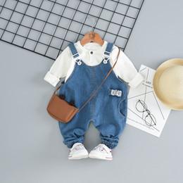 venta al por mayor niños pantalones cortos de camuflaje Rebajas Moda 2019 Spring Baby GirlsJuegos de ropa para niños 1-4 años Trajes de mezclilla para niños Suéter de manga larga + Tirantes Jeans = 2PCS / set