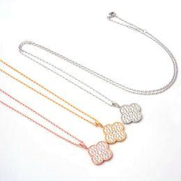 Marca titanium aço jóias atacado grande flor de quatro folhas cheio de diamantes longo colar de Fornecedores de protetor celta pingente