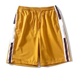 Homens Designer Shorts 4 Cores Carta de Marca de Moda de Verão Impresso no Lado de Luxo Praia Shorts Frete Grátis de