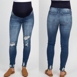 2020 ropa de talla grande Ropa de embarazo tallas grandes Mujer embarazada Pantalones vaqueros rasgados Pantalones de maternidad Prop de enfermería Pierna del vientre # G45US ropa de talla grande baratos