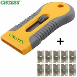 Автомобильная печь онлайн-Пластмассовый Handy Razor Scraper + 10шт. Одностороннее лезвие из нержавеющей стали. Стеклянная духовка. Инструмент для удаления. Упаковочная машина. Чистящий скребок. K07