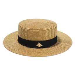 Sombrero de ala ancha tejido a la moda Oro Metal Abeja Gorra de paja ancha a la moda Sombrero de paja tejido con visera plana padre-hijo desde fabricantes