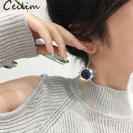 lucido ciondola gli orecchini Sconti Orecchini pendenti di cristallo alla moda girasole per le donne lungo semplice orecchino coreano lucido 2019 lega rotonda orecchini di goccia gioielli partito gioielli