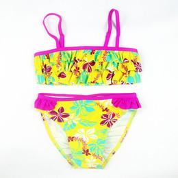 Nuevo verano estilo europeo y americano Flores Bikini Traje de baño para niños Niñas Bikini dividido Niños Traje de baño de capa de pastel desde fabricantes