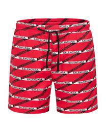 Pantaloncini da spiaggia monogramma a righe da uomo marca pantaloni da spiaggia firmati da uomo estate polo beach surf costumi da bagno europei e americani da