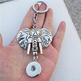 12pcs / lot tête d'éléphant tibétain en métal 18mm boutons-pression porte-clés porte-clés bijoux unisexe ? partir de fabricateur