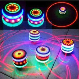 bunte flash-spinnerei Rabatt Interessantes Kinderspielzeug Bunte Flash LED Licht Kreisel Laser Musik Gyroskop Kinderleuchtende Musik Gyro