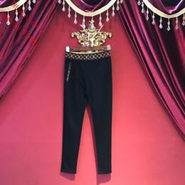 leggings de pé preto Desconto 2019 novas mulheres calças de moda slim buraco esportivo leggings de fitness lazer pés calças de suor preto ocasional elástico fino calças mulheres roupas