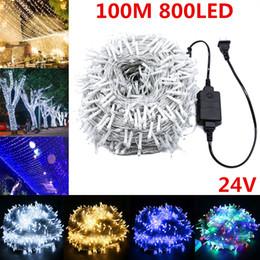 luces de navidad seguras Rebajas 24V voltaje seguro luz LED de cadena 100M Hada Garland Lámparas de Navidad de la boda del jardín de la escalera decoración al aire libre Cuerdas CA 110V-240V