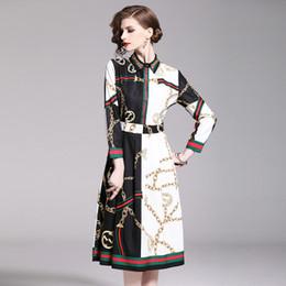 2019 longueur de la tunique féminine Street Fashion New Robes, Robe imprimée pour femmes, Col rond et manches longues, Printemps et été Jupes mi-longues