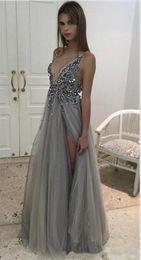 d6efa81e6928 2019 New Deep V Neck Sheer Straps Paillettes in rilievo Tulle Split  Backless Celebrity Dresses Abiti da ballo lunghi Silver Grey Abiti da sera  sexy vestito ...