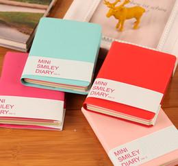 Yeni Sevimli Renkli Mini Gülümseme Deri Dizüstü 8 * 10.5 CM öğrenci için ofis not defterleri Moda Günlüğü İş ofis kitap nereden