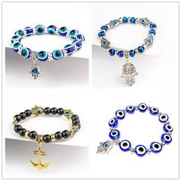 Joyería azul campana online-Mano de Fátima Pulsera Hamsa Joyería Mujer Hombre Oro Plata Color Moda Diablo azul Mal de ojo malvado Bell Con cuentas Anchor Charm pulseras para niñas