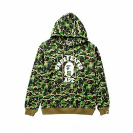 Suéter jersey verde online-Venta al por mayor nuevo otoño invierno hombres mujeres púrpura verde Camo Pullover Jacket Hoodies otoño invierno adolescente Full Ziper Hip Hop suéter