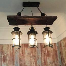 Colgante de metal tonos claros online-Lámpara colgante de madera forjada industrial Woody Lámpara colgante Lámpara colgante Luces de celda Jaula de metal con pantalla de vidrio para barra interior