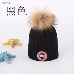 7bf20788197 2019 new fashion CANADA mens designer hats bonnet winter beanie knitted  wool hat plus velvet cap skullies Thicker mask Fringe Goose beanies  discount ...