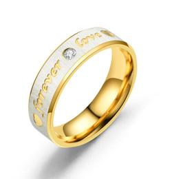 5b446b5bcc3b Los amantes de la marca de boda de titanio de acero anillo de la banda para  las mujeres Zirconia oro rosa anillos de compromiso hombres joyería regalos  ...