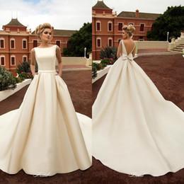 vestido de boda de bolsillos arco Rebajas 2020 nuevos vestidos elegantes de la boda de playa del satén con los bolsillos de los vestidos sin espalda vestido de arco de playa de Boho una línea sin respaldo novia de la boda