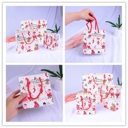 4266ade7268 Santa Claus Christmas Paper Candy Gift Bags Cartoon Packaging  ChristmasCandy Handle Paper Bag Small Middle Large Size to Choose