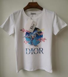 Nouveau mode femmes designer t-shirt décontracté chemises col rond planche à roulettes Harajuku manches courtes impression de fleurs coton été blanc t-shirts ? partir de fabricateur