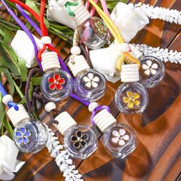 2019 óleo de fragrância para difusor 8-10ML Hanging Perfume Car Garrafa flor fragrância difusor Bottle Air Freshner vidro Frasco de petróleo essencial Car Detalhes no LJJA3231-8 óleo de fragrância para difusor barato