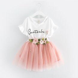 colore camicia verde stile Sconti 2 colori ragazze INS lettere fiore set 2019 nuovi bambini moda t shirt manica corta + gonna corta 2 pezzi set rosa vestito verde K0168