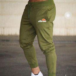 Мужские бегуны повседневные брюки Фитнес Спортивная одежда Брюки узкие спортивные штаны Черные спортивные штаны для бегунов для бодибилдинга от