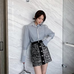 Paquet de mots en Ligne-2019 produits d'été de femme concise solide taille haute pu peau demi corps jupe tout match paquet fesses une jupe mot