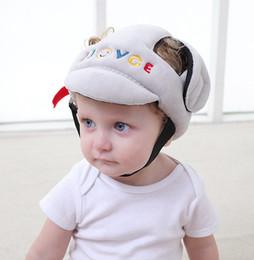 Cascos de seguridad para niños online-bebés recién nacidos niños niñas protegen la cabeza casco de seguridad sombreros contra la lucha contra las gorras para los niños a evitar el juego caminar impacto
