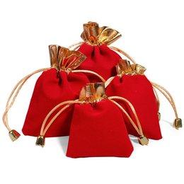 2019 farfalle organza viola Sacchetti di alta qualità 100pcs / lot in rilievo sacchetti di velluto coulisse 3 colori 2 formati imballaggio dei monili del partito regalo di nozze borse nero rosso