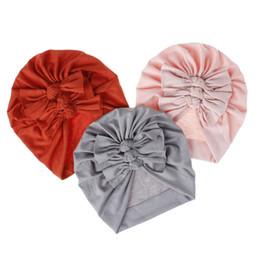 Fiori di caramella online-Berretto in morbido tessuto Candy color puro per bambini cappelli per bambini primavera autunno inverno cappelli per bambini 18 colori con fiocco grande