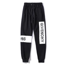 Nuovi pantaloni cerniera laterali hip hop Fear Of God Moda abbigliamento  urbano bottoms rossi justin bieber pantaloni da jogging FOG nero rosso blu  moda ... 2d080df2d12f