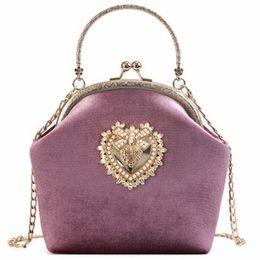 frizioni in velluto Sconti Borsa da donna in velluto con perla vintage Borsa da sera in velluto a forma di cuore con design vintage