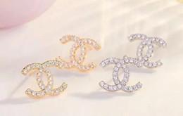 pendientes para niñas diseños de oro Rebajas Joyería de diseño de marca famosa de alta calidad Estilo de acero inoxidable de lujo Pendientes chapados en oro Stud para niña mujer 7625