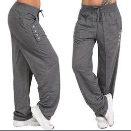 Botones de pantalones holgados online-Pantalones de harén de las mujeres Botón con cordón Pantalones anchos de pierna ancha Pantalones de las señoras ocasionales Color sólido Loose Fitness Pantalones de talla grande