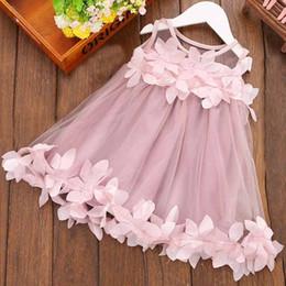 Nouveau style de robe d'été petite fille en Ligne-Robe de bébé 2019 nouveau style de la mode d'été douce et jolie petite fille Appliques Pétales Halter Princess Dress Korean enfants.