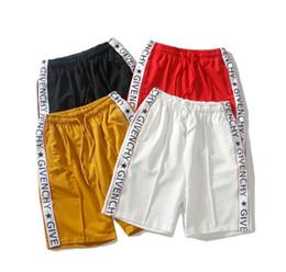 Sueltos pantalones de verano hombres online-Diseñador New Summer Mens Side Stripe Shorts Men Beach Shorts Skateboard Pantalones cortos Loose brand short bermuda Jogger