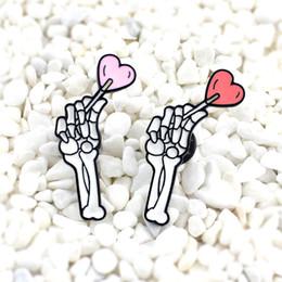 Argentina Pasadores de esqueleto y corazón Pasadores de esmalte de hueso Pasadores de solapa Broches Joyas punk Joyas de cráneos cheap heart lapel pins Suministro