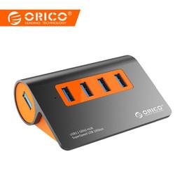 accesorios de aluminio de china Rebajas ORICO Aluminio 4 puertos USB3.1 Hub 10 Gbps Velocidad de transmisión estupenda Divisor USB con 12V Adaptador de corriente para accesorios de computadora