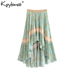 45a9906575 Boho Chic Verano Vintage Estampado Floral Falda Plisada Asimétrica Mujeres  2019 Moda Cintura Elástica Playa Faldas Largas Faldas Mujer