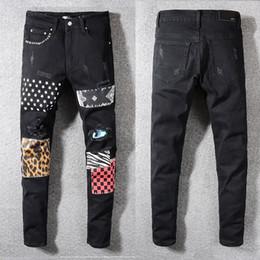 Оптовая Европейский и американский бренд уличной моды печатных джинсы патч камуфляж самосовершенствование ходьба шоу мужские джинсы Амири supplier street fashion wholesale от Поставщики уличная мода оптом